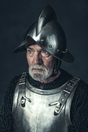 nobleman: Portrait of knight with gray beard in armor. Stock Photo
