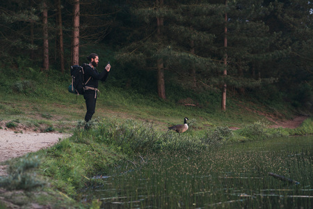 bank records: Hiker taking pictures of nature with smartphone