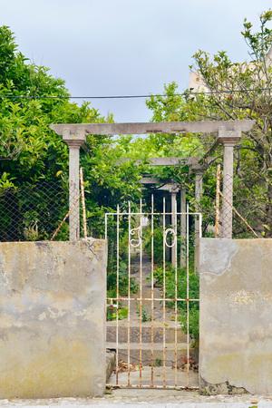 garden gate: White iron garden gate at abandoned garden. Mallorca. Spain.