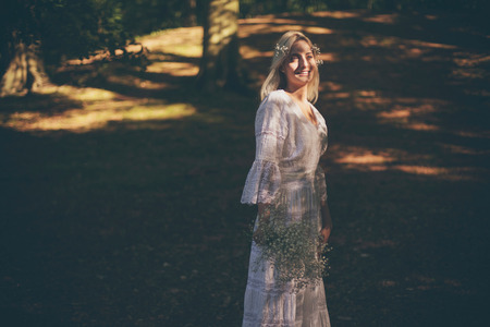 dappled: Single bride in dappled sunlight of forest Stock Photo