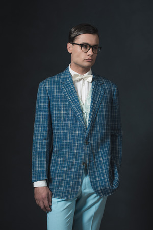 dandy: Retro 1920s dandy man wearing blue checkered jacket and pants.
