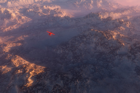 misty: Misty snow mountains in morning mist with airplane flying over Stock Photo