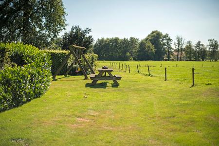 picknick: Wooden picknick table in garden. Winterswijk. Achterhoek. Gelderland. The Netherlands.