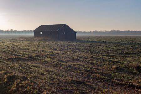 old barn: Old barn in misty farmland. Achterhoek. Gelderland. The Netherlands. Stock Photo
