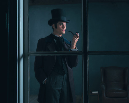 dickens: Dickens style man smoking pipe looking out window.