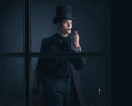 scrooge: Dickens style man smoking pipe looking out window.