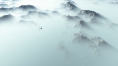 smoky mountains: Aerial of single engine airplane over mountain range in thick layer of mist.