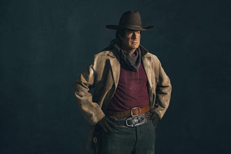 actor: Retro late 1960s western actor. Studio portrait.