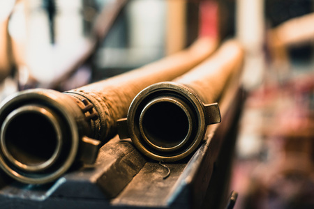 Close-up of nozzles of old fire hoses. Stock Photo