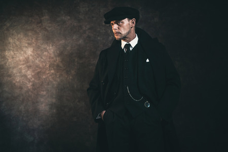 distinctive: Retro 1920s english gangster. Peaky blinders style. Stock Photo
