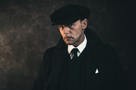 blinders: Retro 1920s english gangster. Peaky blinders style. Stock Photo