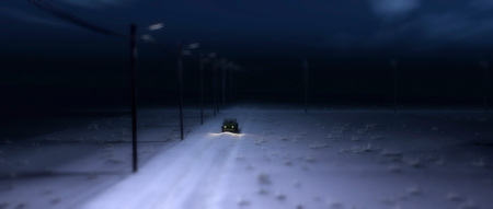 Four-wheel drive vehicle on rural road covered in snow at night.