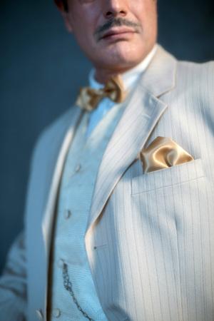 Retro 1920s white striped suit with golden pochet. Stock Photo