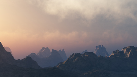 Peaky mountains under cloudy sky at sunset.