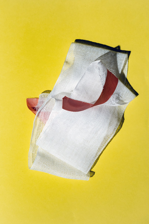 Bandage with tape on yellow. Top view. Standard-Bild - 121676152