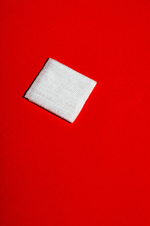 Bandage mesh on red floor. Top view. Stock Photo