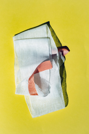 Bandage with tape on yellow. Top view. Standard-Bild - 121676252