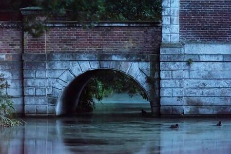 Ancient bridge of country house at dusk.