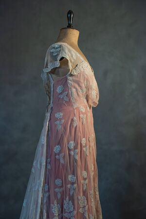 Vintage mannequin bust with pink victorian dress. Side view.