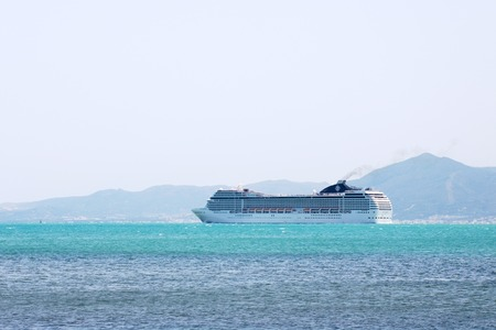Big cruise liner goes into the open sea.