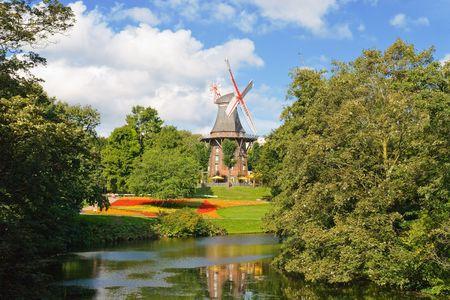 Windmill near a river in Bremen, Germany Stock Photo
