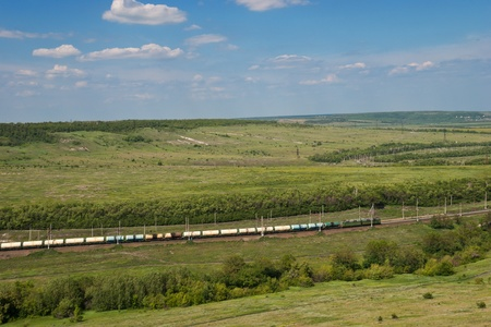 coutryside: Freight Train Going by Railway Against Summer Landscape