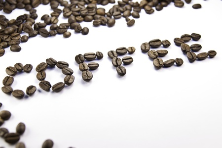 Coffee written with coffee beans on a white background