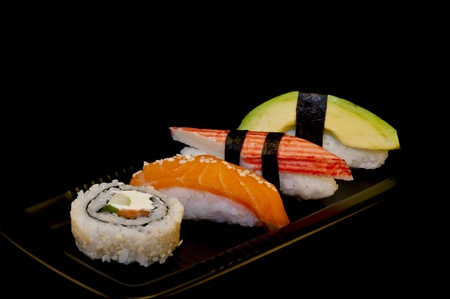 Four sushi on a black plate Stock Photo