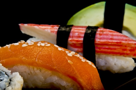 Four sushi on a black background Stock Photo