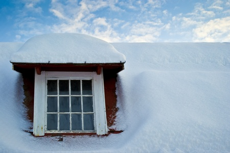Old window and snow covered roof