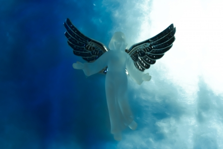 Angel in heaven with clouds all around Stock Photo