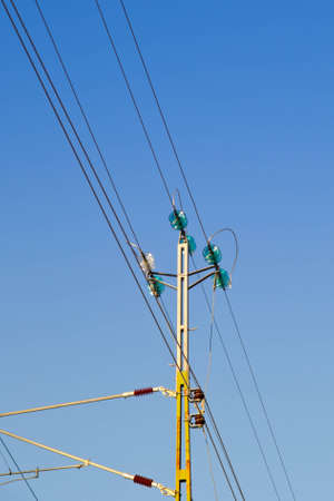 overhead lines for railway with a blue sky in the background