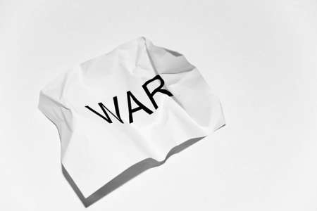 white crumpled paper with the word war on