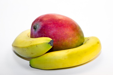two bananas hugging a mango on a white background Stock Photo - 12804714