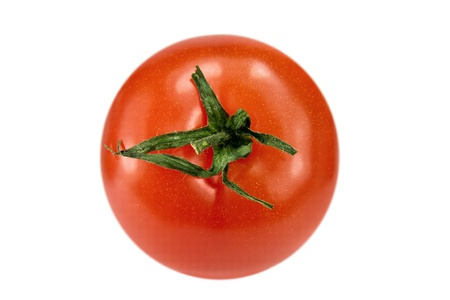 Ripe tomato with a small twig on white background