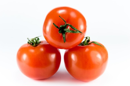 Three stacked ripe tomatoes on a white background Stock Photo - 13319569