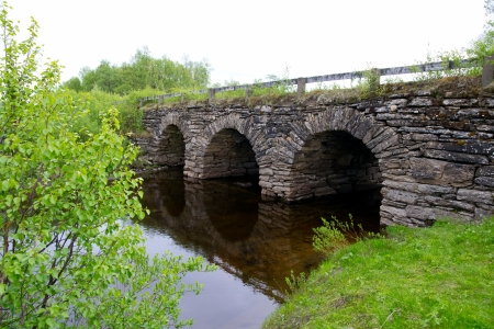 tunneling: old stone bridge with three tunnels