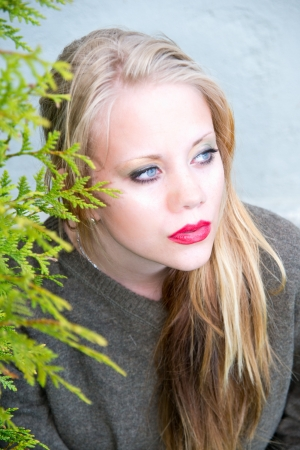 young woman with red lips which looks into the distance Stock Photo