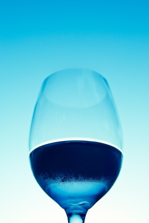 wine glass with water against a blue sky in the evening