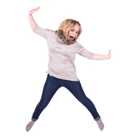 young woman jumping with arms out and look happy photo