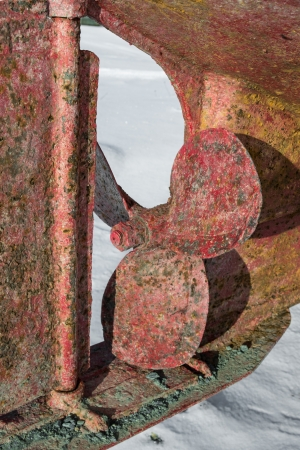 old rusty propeller on a boat hull Stock Photo