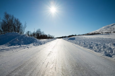 winter road: very slippery road with plow edges alongside