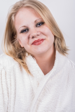 Fresh healthy and early bird young woman in bathrobe