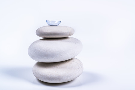 contact lens on a pile of white stones with a white background
