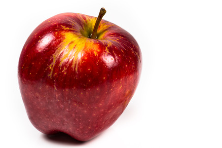a beautiful red delicious apple on a white background