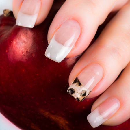 nails: nails with a French manicure and foil on one of the nail tips