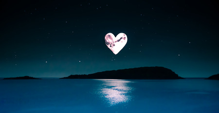 sky with heart shaped moon and lots of stars over a calm sea in the middle of the night