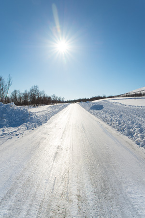 extremely slippery winter road on a sunny day in the Swedish mountains