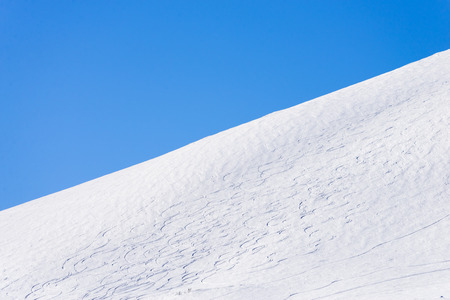ski slope with ski tracks a beautiful winter day in the Swedish mountains photo