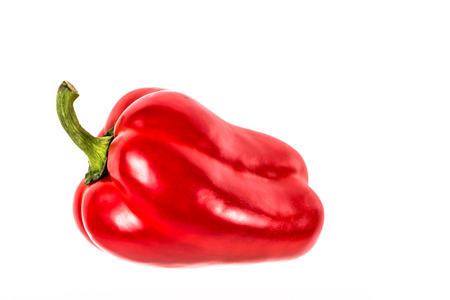 studio picture of a single red bell pepper on a white background